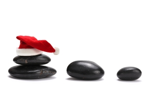 bigstock_stack_of_stones_with_red_santa_16253516 (1)